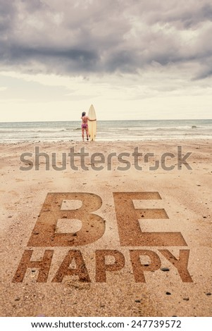 Calm woman in bikini with surfboard on beach against be happy - stock photo