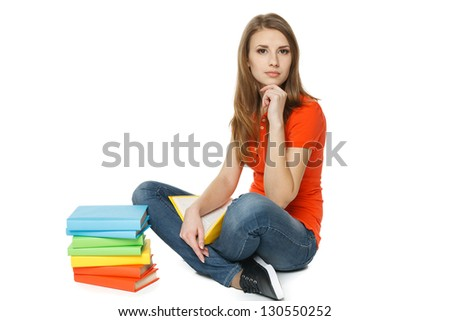 Calm woman sitting on the floor with stack of books, over white background