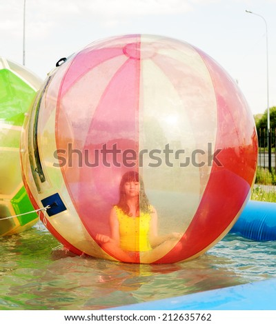 Calm young girl sitting in the ball and practicing yoga - stock photo