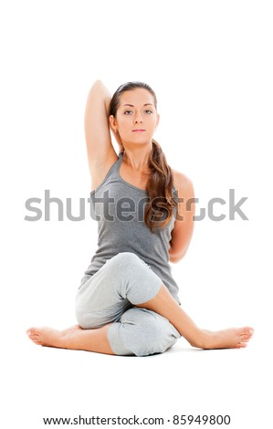 calm young woman doing yoga exercise. isolated on white background - stock photo