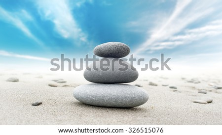 Calm zen meditate background with rock pyramid  - stock photo