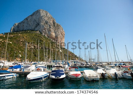 Calpe Alicante marina boats with Penon de Ifach mountain in Mediterranean sea of Spain