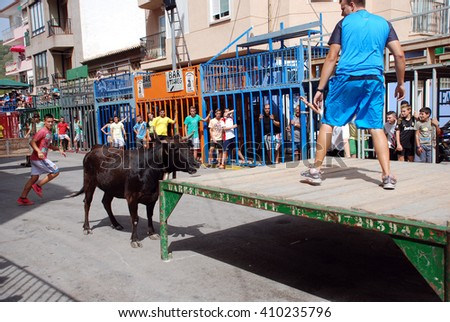 CALPE, SPAIN - AUGUST 8: Bous al Carrer August 8, 2012 in Calpe, Spain. A traditional bull run through the streets of Calpe  - stock photo
