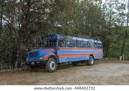 CALPULALPAM, OAXACA, MEXICO- MARCH 22, 2016: Traditional mexican bus parking at the woods in the magical town of Calpulalpam, Oaxaca, Mexico - stock photo
