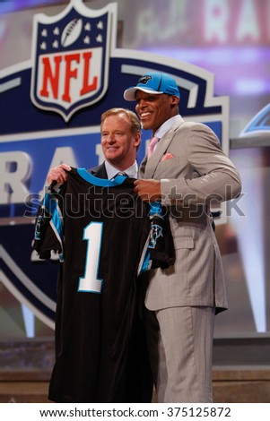Cam Newton (R) is introduced by Commissioner of the National Football League Roger Goodell as the first pick to the Carolina Panthers at the NFL Draft 2011 at Radio City Music Hall in New York, NY. - stock photo
