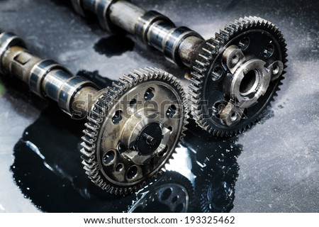 cam shaft of a turbo diesel engine on a dark background - stock photo