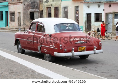 CAMAGUEY, CUBA - FEBRUARY 17: Classic American Chevrolet car parked in the street on February 17, 2011 in Camaguey, Cuba. The multitude of oldtimer cars in Cuba is its major tourism attraction. - stock photo