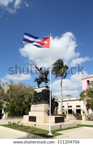 Camaguey, Cuba - old town listed on UNESCO World Heritage List. Main square and Cuban flag. - stock photo
