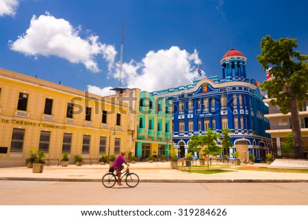 CAMAGUEY, CUBA - SEPTEMBER 4, 2015: Street view of UNESCO heritage city centre, old square with bicycles used for transportation - stock photo