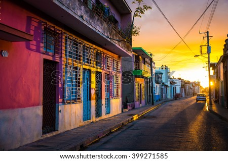 Camaguey, CUBA - The warm sunset light shines on the empty streets of the world heritage city centre in the Cuban city of Camaguey, an unique latin american city in the Caribbean -  January 2016