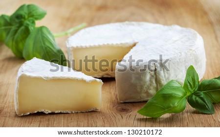 camambert cheese on wooden cutting board - stock photo