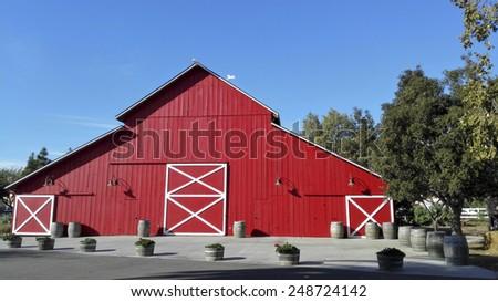 CAMARILLO, CA - JANUARY 27, 2015: Historic Red Wooden Barn at Camarillo Ranch; City of Camarillo museum of founder of the city Adolfo Camarillo - stock photo