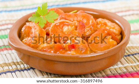 Camarones Enchilados - Cuban style shrimp in a tomato based sauce. - stock photo