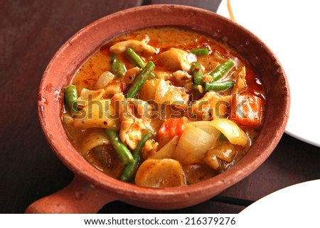 Cambodia chicken curry served in a clay bowl