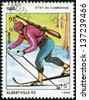 CAMBODIA - CIRCA 1990: A post stamp printed in Cambodge shows sportsman and devoted the winter olympic games in Alberville, series, circa 1990 - stock photo