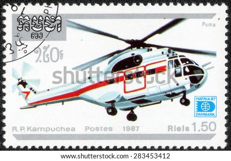 """Cambodia - CIRCA 1987: A stamp printed in the Cambodia shows a series of images """"Helicopters"""", circa 1987  - stock photo"""