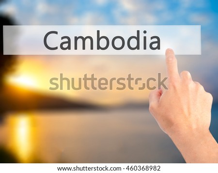 Cambodia - Hand pressing a button on blurred background concept . Business, technology, internet concept. Stock Photo