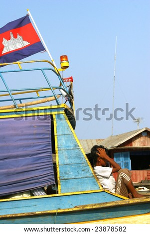 Cambodian boy meditate under cambodian flag - stock photo