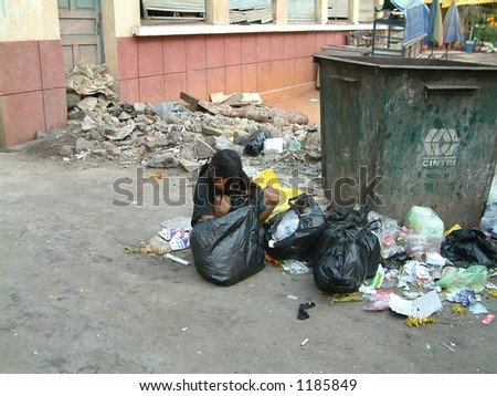 Cambodian girl searching through garbage - stock photo