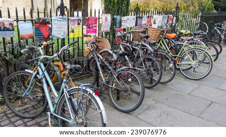 CAMBRIDGE, ENGLAND, UK - OCTOBER 21, 2014: Bicycle and posters in Cambridge UK