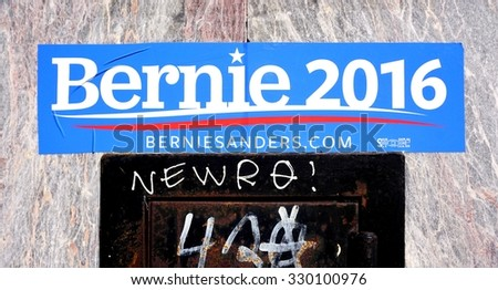 CAMBRIDGE, MA -16 OCTOBER 2015- Sticker supporting the candidacy of Bernie Sanders for the Democratic primary election posted on a street wall in Cambridge, Massachusetts.