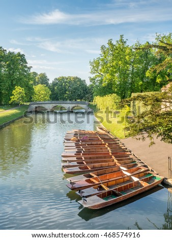 CAMBRIDGE - MAY 23: Wooden punts in Cam river for student stroking in Cambridge, England, on May 23, 2016.