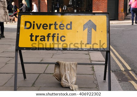 CAMBRIDGE, UK - APRIL 17, 2016:  Continuing development in the city is causing road closures and diversions as illustrated by this 'Diverted Traffic' sign - Illustrative Editorial