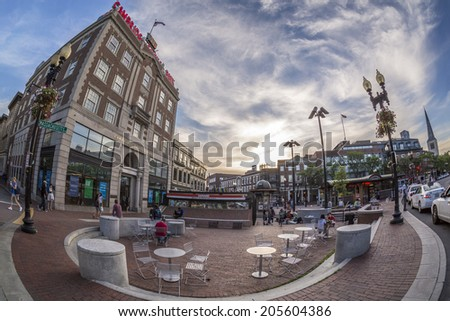 CAMBRIDGE, USA - JUNE 2: Panoramic view of Harvard Square in Cambridge, MA, USA showcasing its historic architecture that surrounds the famous Harvard University on the left side on June 2, 2014. - stock photo
