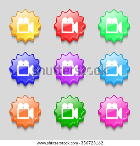 camcorder icon sign. symbol on nine wavy colourful buttons. illustration - stock photo
