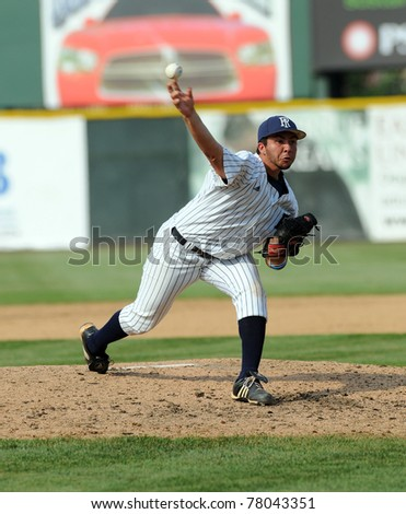 CAMDEN, NJ - MAY 26: Rhode Island pitcher Mike Bradstreet delivers a pitch during an Atlantic Ten baseball tournament game against LaSalle on May 26, 2011 in Camden, NJ. - stock photo