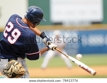 CAMDEN, NJ - MAY 26: Richmond batter Bryan Conway digs for first base after a 'swinging bunt' (ball shown) during an Atlantic Ten baseball tournament game against Charlotte on May 26, 2011 in Camden, NJ. - stock photo
