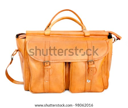 camel color leather travel bag isolated over white background - stock photo