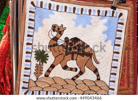 Camel figure embroidery on fabric