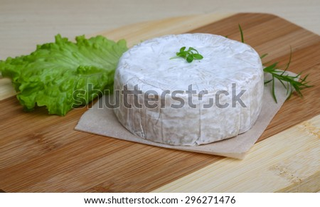 Camembert brie cheese with herbs on the wood background - stock photo