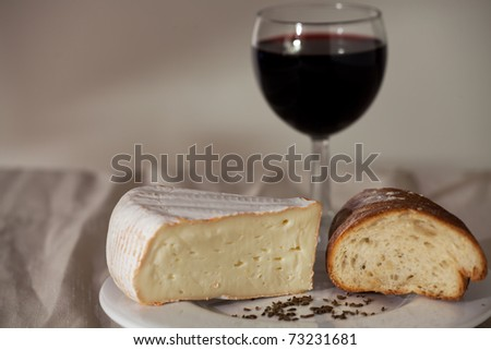 camembert cheese and a glass of wine