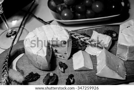 Camembert cheese on the wooden board