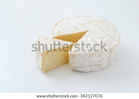 camembert cheese slice isolated on white - stock photo