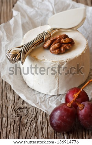 Camembert cheese with walnut and grape. - stock photo