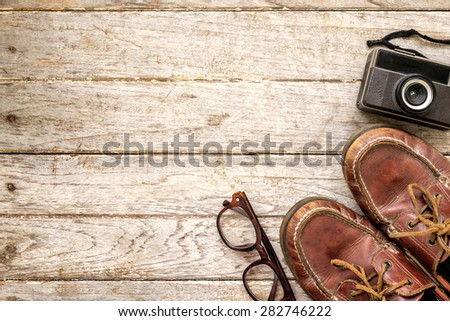 Camera and glasses and Leather shoe on a wooden , Still life travel on wooden