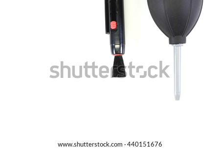 Camera cleaning tools isolated on white background.