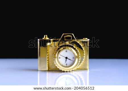 Camera clock on the reflective surface of the glass - stock photo