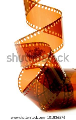 Camera film strip over a white background - stock photo