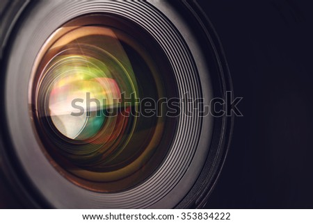 Camera lens detail, front glass of wide angle photography DSLR camera lens, macro shot, selective focus - stock photo