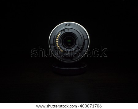Camera Lens on black background. Rear side. - stock photo