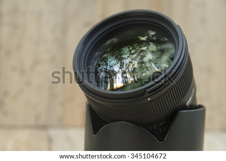Camera lens with lense reflections. - stock photo