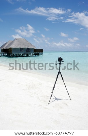 Camera on a beach. - stock photo