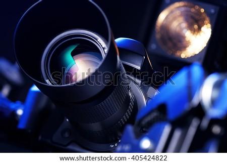 camera on a black background - stock photo
