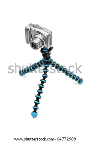 Camera on a tripod isolated on a white background. - stock photo