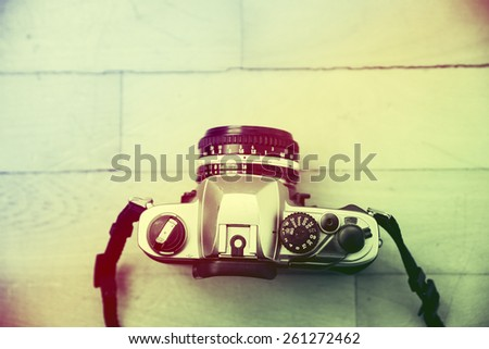 Camera on wood table background - stock photo