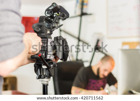 Cameraman is filming a movie scene - stock photo